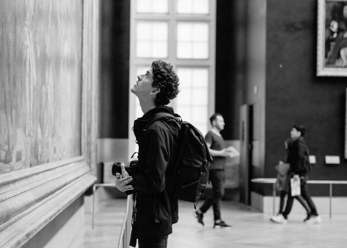 josh looking at painting-louvre